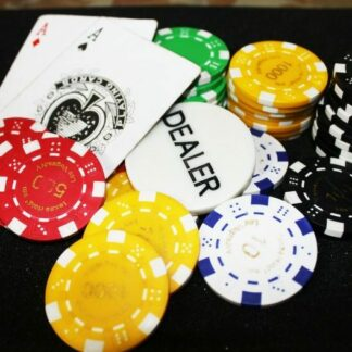 poker chips and dealer buttons