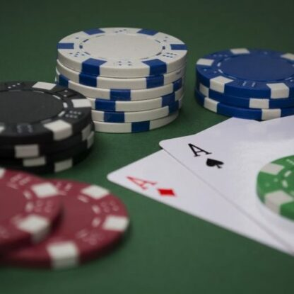 poker hand with chips and cards